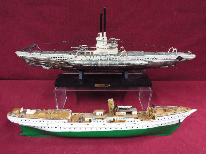 A resin model on stand of a U-Boat measuring approximately 20cms (H) x 48cms (L) x 7cms (W)