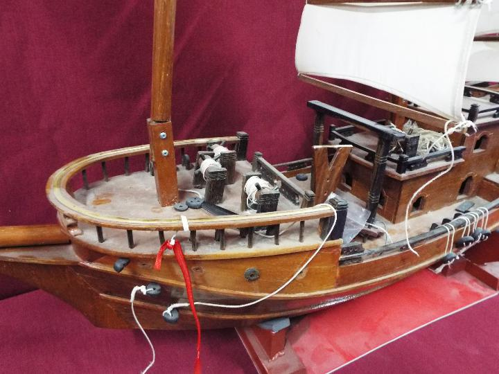 A static wooden model of a Chinese Junk. - Image 3 of 5