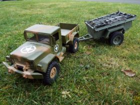 R/C plastic model 4X4 US army truck with working lights and front and rear suspension.