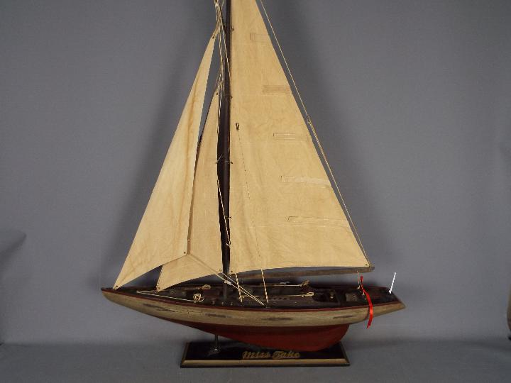 A large static model of a sea going yacht 'Miss Take'.
