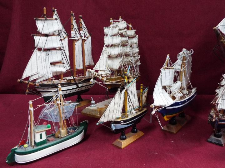A flotilla of ten static wooden models on stands depicting fishing vessels, - Image 2 of 4