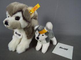 Steiff - Two Steiff dogs comprising # 104985 'Bernie The Husky' (15 cm h),