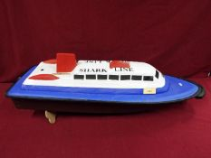 A moulded plastic model of a passenger 'Shark Line' ferry boat entitled 'Jaws'.