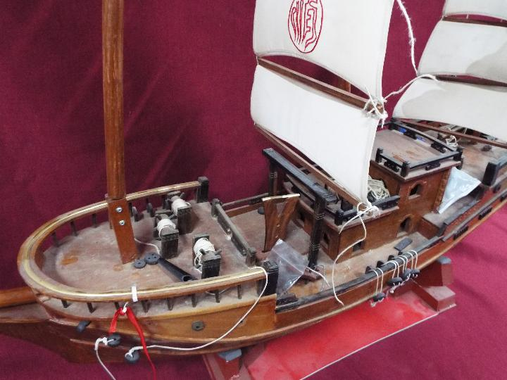 A static wooden model of a Chinese Junk. - Image 5 of 5