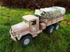 An RC controlled military truck with power bank and flashing lights.