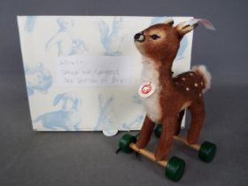 Steiff - A boxed, limited edition Steiff # 681417 'Fawn On Wheels ornament', white tag,