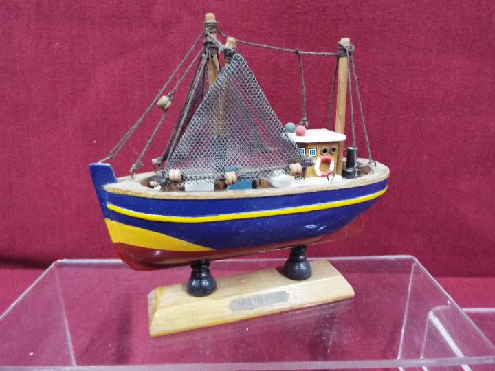 A flotilla of five static wooden models on stands depicting fishing vessels. - Image 4 of 4