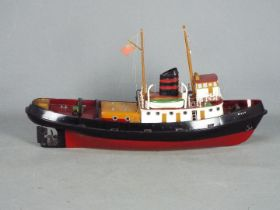 A kit built RC model of a tug Boat 'Billy'.