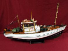 A scratch built model constructed in wood and plastic of a fishing vessel.