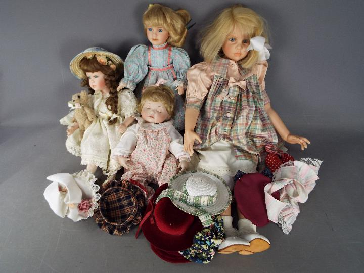A vinyl dressed doll of a young girl likely by Waltershauser Puppenmanufaktur,