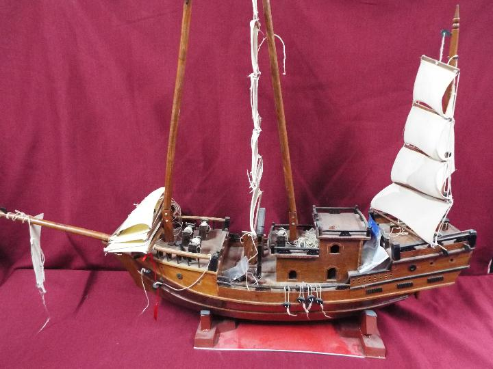 A static wooden model of a Chinese Junk.
