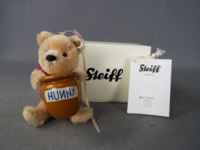 Steiff - A boxed, limited edition Steiff 'Winnie The Pooh with Honey Pot' ornament, # 682933,