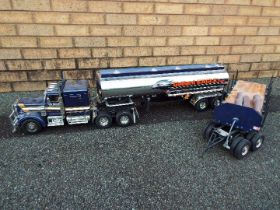 Tamiya - 1/14 R/C Grand hauler truck model with Gallant EAGLE fuel tanker and flatbed trailer.