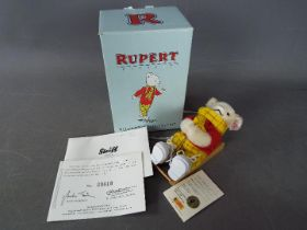 Steiff - A boxed limited edition Steiff Rupert The Bear ornament # 653537, white tag,
