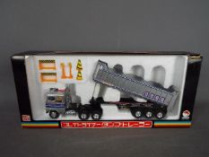 Shinsei - A boxed Shinsei Mini Power #634 Articulated Tipper Truck.
