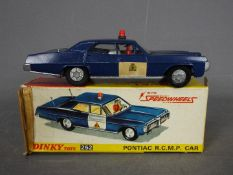 Dinky Toys - A boxed  Dinky Toys #252 Pontiac (Parisiiene) Royal Canadian Mounted Police Car.