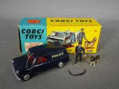 Corgi Toys - A boxed Corgi Toys #448 BMC Mini Police Van with Tracker Dog.