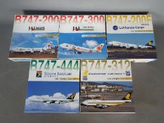 Dragon Wings - Five boxed diecast 1:400 scale model Boeing 747 aircraft in various carrier liveries
