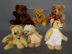 Hermann Bears - six Hermann Bears, two dressed and others,