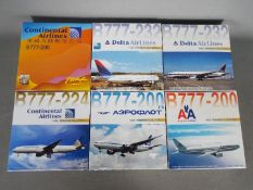 Dragon Wings - Six boxed diecast 1:400 scale model Boeing 777 aircraft in various carrier liveries