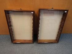 Two wall mounted glass display cabinets with glass shelves measuring approximately 63cms (H) x