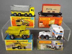 Matchbox - Four boxed Matchbox Superfast diecast vehicles.