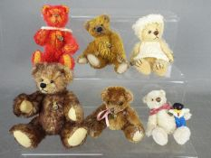 Hermann Bears - six Hermann Bears to include one dressed, one holding a golly and others,