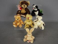 Hermann Bears - six Hermann Bears to include one in the form of a panda, a larger bear with red tag,