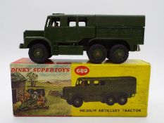 Dinky Toys - A boxed Dinky Toys #689 Medium Artillery tractor.