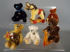 Hermann Bears - six Hermann Bears to include one riding a scooter approx height 9 cm,