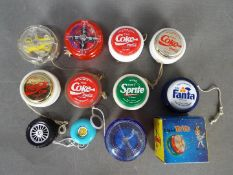 Yo-Yo's - A collection of 11 Yo-yo's one is boxed the others are loose.