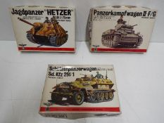 Three Bandai WWII German Panzertruppe / Pin Point series model kits. 1:48 Scale. # 8239 Series No.
