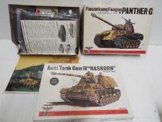 Two Bandai - WWII German Panzertruppe tank model kits. 1:48 Scale. Both unmade.