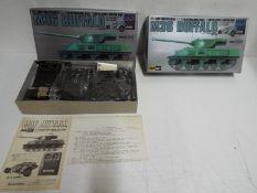 Mitsuwa Model - 2 boxed unmade 1:48 scale motorised remote control M36 Buffalo tanks.
