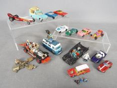 Corgi, Matchbox, Hot Wheels - A small collection of unboxed diecast vehicles in various scales.