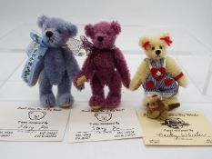 Small Bears For A Big World - Becky Wheeler bear with dog on a lead named Sweety Pie in Mint