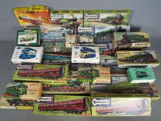 Kitmaster - Airfix - MTS - A lot of 24 mostly part built 00 scale model kits of locos and carriages