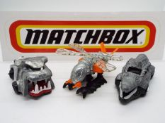 Matchbox - Three 'First Shot' diecast vehicles by Matchbox. Lot includes #73 'Rottwheeler'.