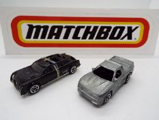 Matchbox - An Experimental Matchbox Cadillac Limousine with a Matchbox 'First Shot' Buster Pick-Up.