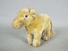 Steiff - An unboxed vintage Standing Blonde Ox Bull probably by Steiff.