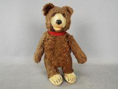 Steiff - A dark brown mohair bear probably by Steiff.