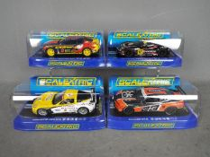 Scalextric - 4 x Chevrolet slot cars, 2 x Camaro's and 2 x Corvettes.