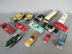 Dinky Toys, Corgi Toys, Matchbox - A collection of 14 unboxed diecast model vehicles.