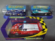 Scalextric - 3 x Maserati MC12 models in various colours and liveries including Vodafone. # C2784.