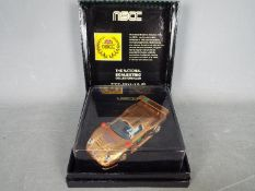 Scalextric - Porsche 911 GT1 in Gold Giesse livery,