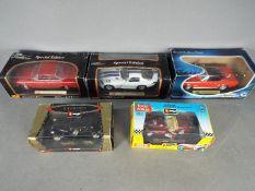 Maisto, Bburago, Solido - Five boxed diecast vehicles in 1:18 and 1:24 scale.