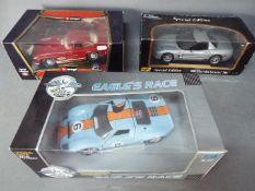 Universal Hobbies, Bburago, Maisto - Three boxed 1:18 scale diecast vehicles.