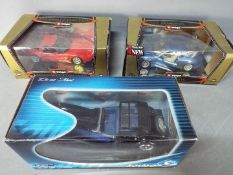 Bburago, Solido - Three boxed diecast model cars in 1:18 scale.