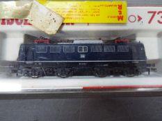 Fleischmann - A boxed Fleischmann #7335 N gauge electric locomotive 110 222-7 in DB blue livery.