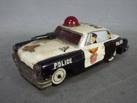 Yoshiya - An unboxed vintage Japanese tinplate 'Bump-N-Go' Police car by Yoshiya.